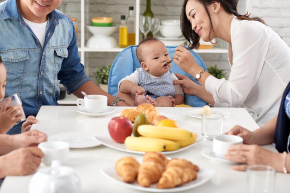 Happy asian family at breakfast Free Photo